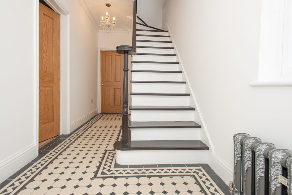 hallway-refurbishment-using-black-and-white-tiles-and-steps