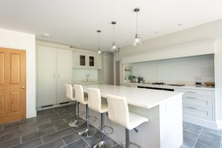 white-fitted-kitchen-renovation-with-stools-at-breakfast-bar
